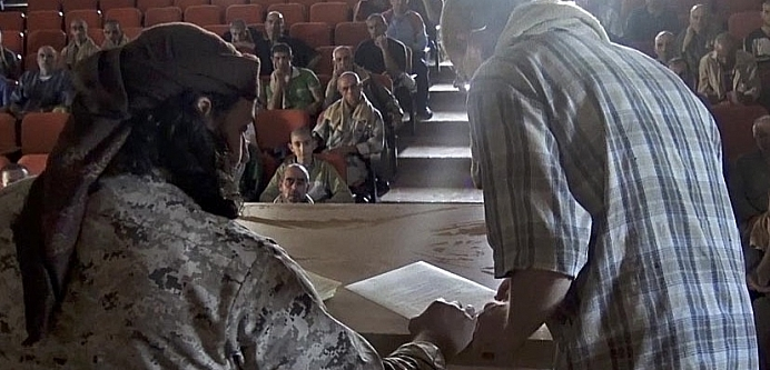 Islamic State member gives Dhimma second class contracts for Christians to sign Islamic State